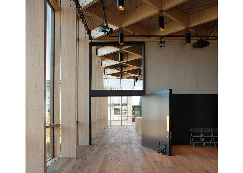 'Babuche' beech LVL has a timber slat soffit, behind which is acoustic insulation.