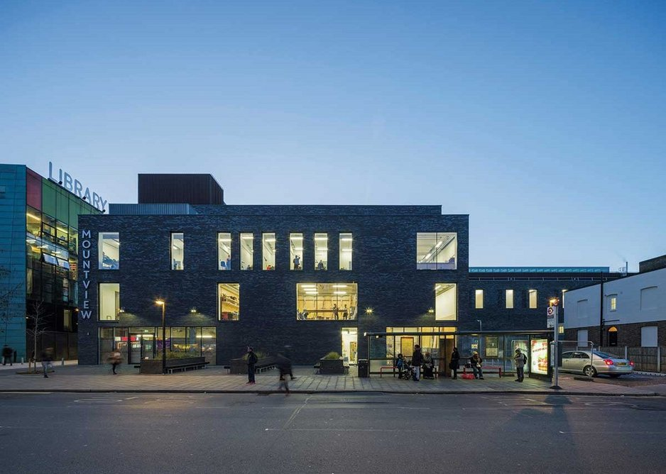 The rear elevation is less imposing and more informal, to deal with smaller scale of the street.