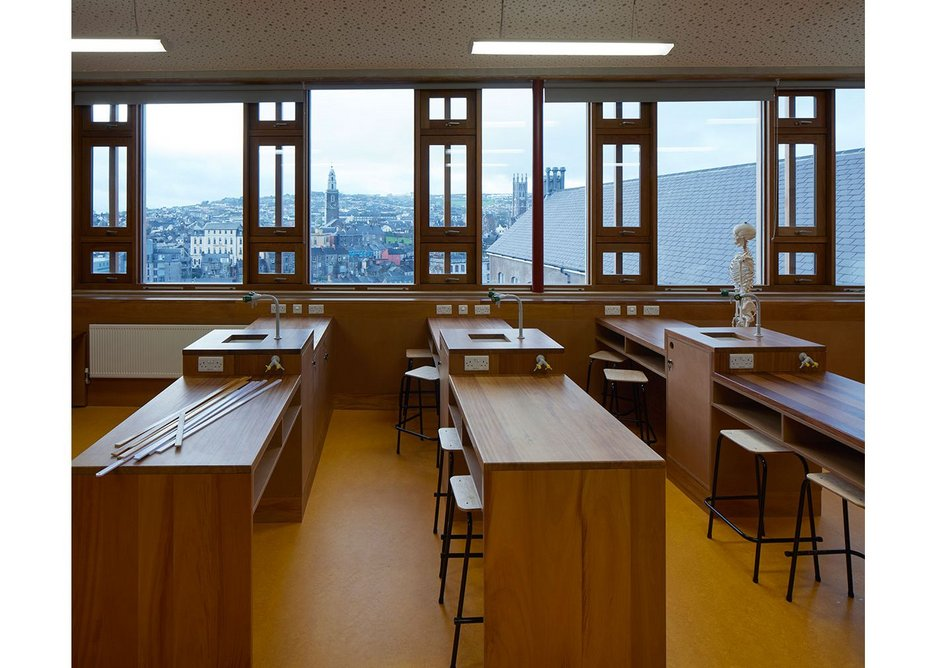 Past screen-like windows, classrooms in both arts and science blocks, some with bespoke furniture, are afforded dramatic views.