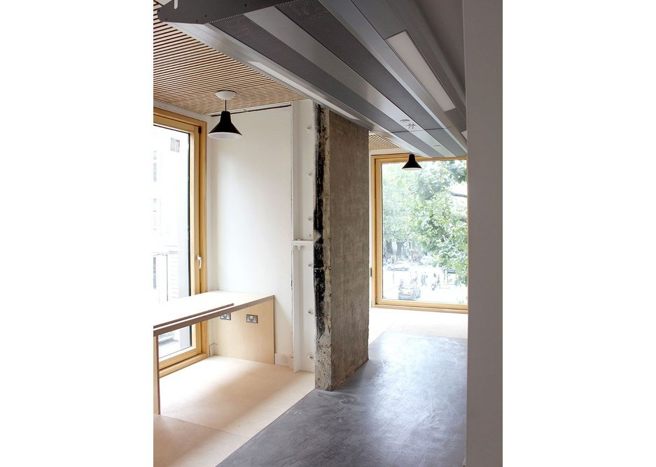 The new facade line with bespoke study spaces is extended from the original concrete structural line.