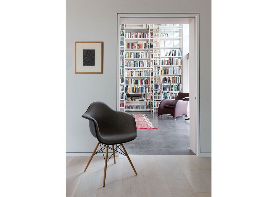 Door frames are painted white in an otherwise grey house as a way of harmonising with the paintings.