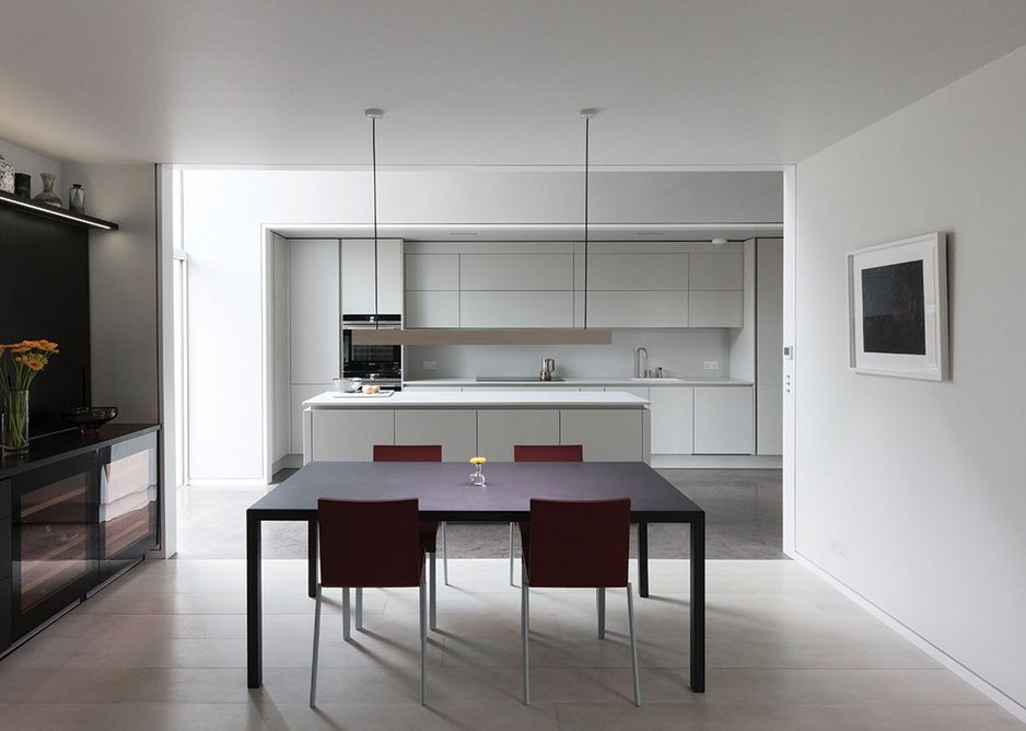 An open-plan dining room feeds off the central hallway and living room.