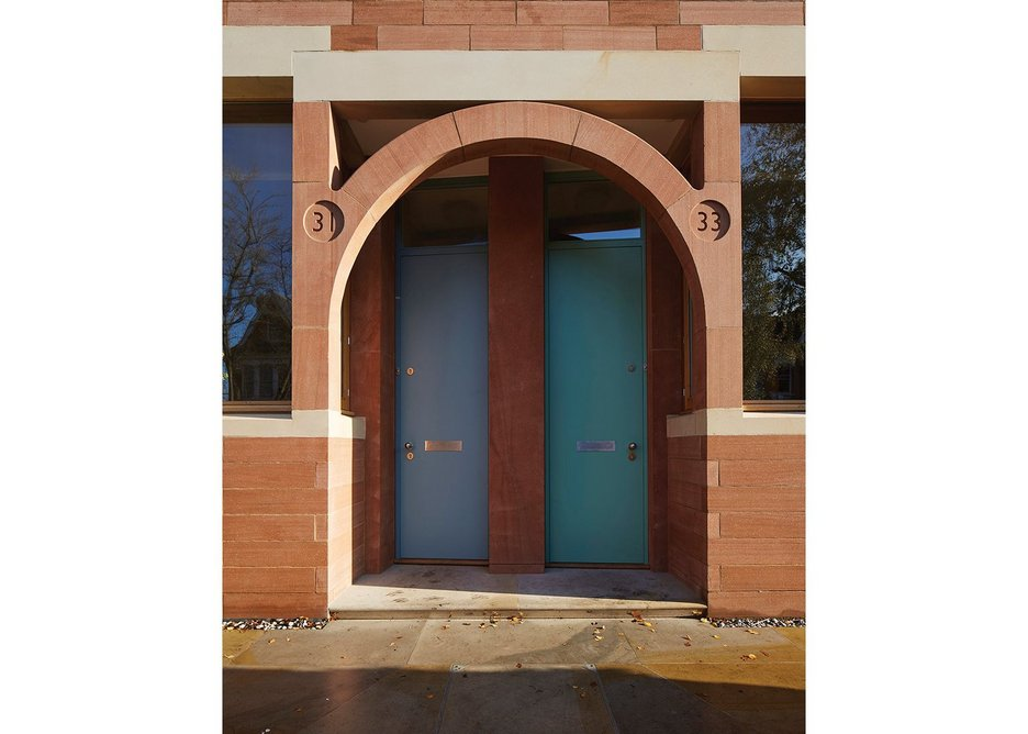Red and white sandstone tie the entrances together.
