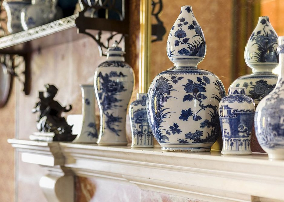 The blue-and-white china displayed on the mantlepiece in the bath room.