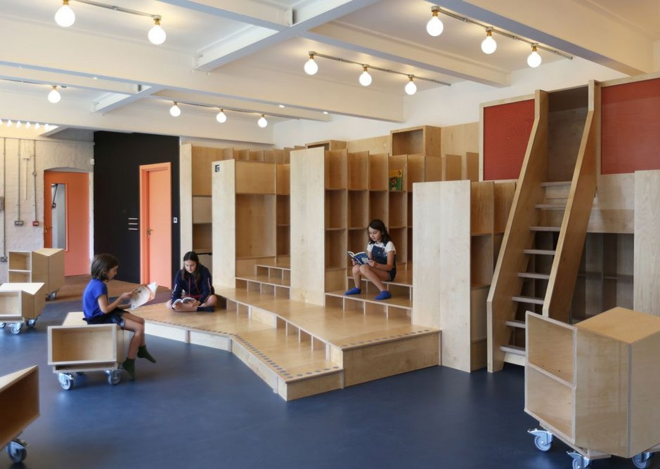 Designed by Jan Kattein Architects, the Thornhill Primary School library incorporates a variety of settings for reading including a mezzanine nook.