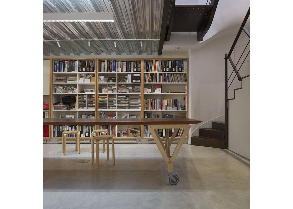 Re-used bookshelves and a plain soffit in the lower ground floor.