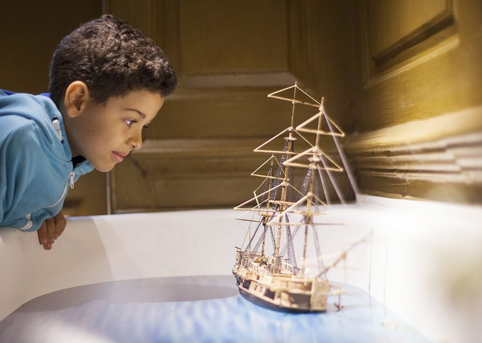 Visitor with diorama in bath photo.