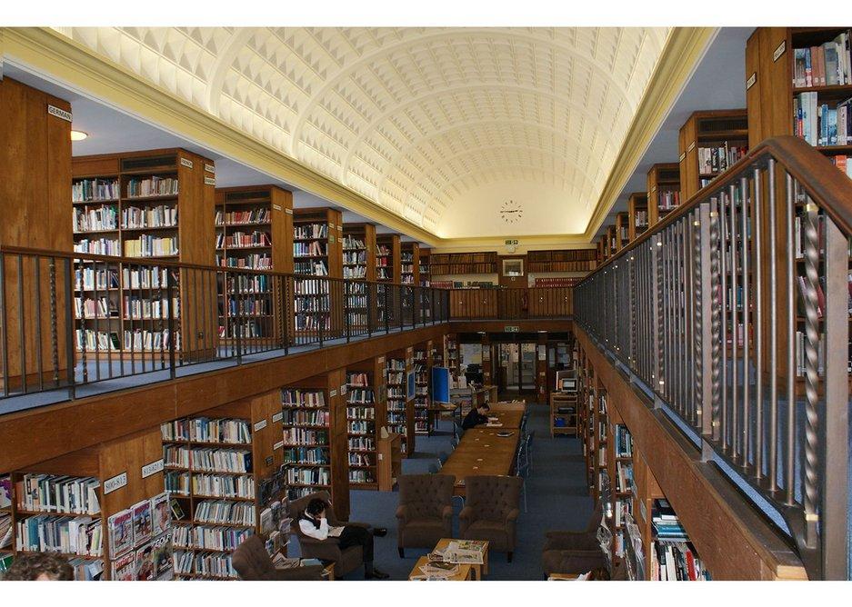 The slightly oppressive alcoves enclosed by full height bookshelves…