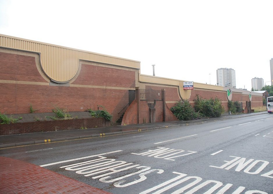 The brick walls and steel profile cladding of the original warehouse from Garscube Road.