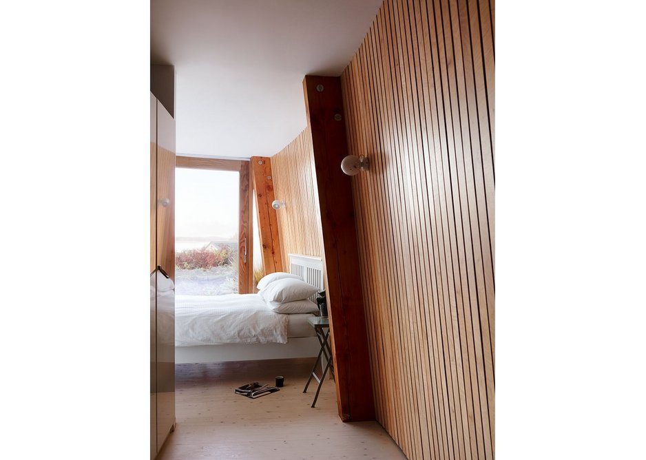 Cabin-like bedrooms are enveloped in a textural surface.
