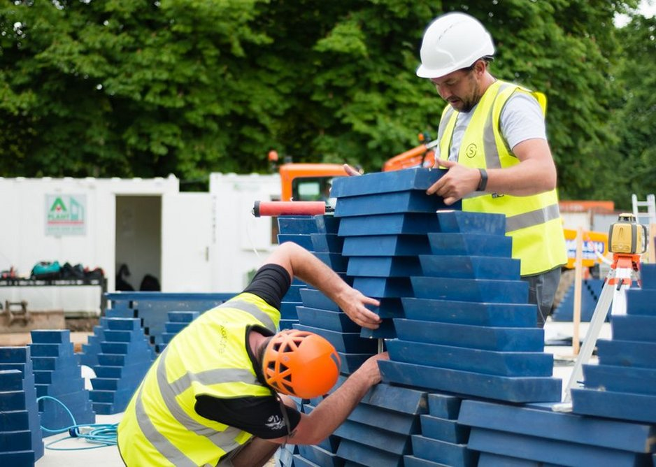 Slotting into place the stacked triangles that will make up the African-fabric pattern of Kéré's Serpentine Pavilion.
