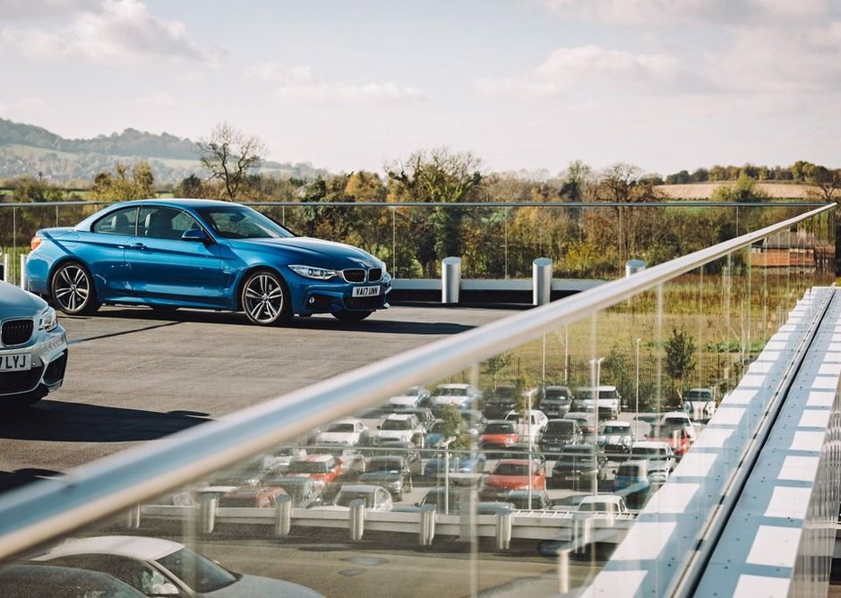 Q-railing's Easy Glass Pro balustrade system is a natural fit for the external terraces at Cotswold Cheltenham BMW.