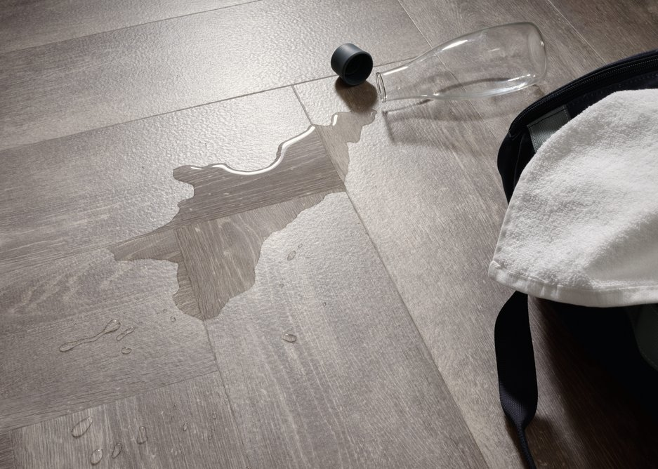 Wood-effect Alpine Oak Signature 36+ luxury vinyl tiles. All flooring in the 36+ ranges features a Quantum Guard urethane layer that makes the tiles easy to clean without the need for polish.