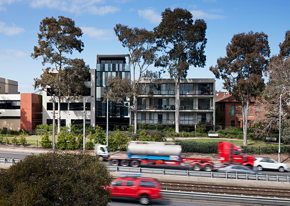 The highway elevation is flat with a more commercial office appearance.