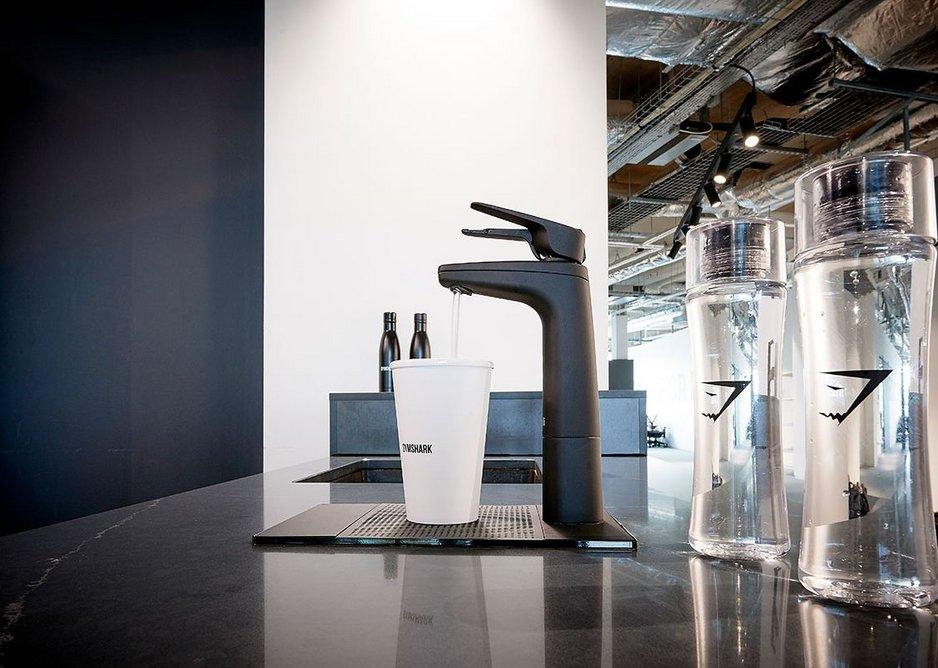 Billi Quadra Plus 15 system with Matte Black tap and font at fitness apparel brand Gymshark's Birmingham headquarters.