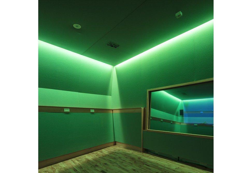 Sensory room  lit in green.