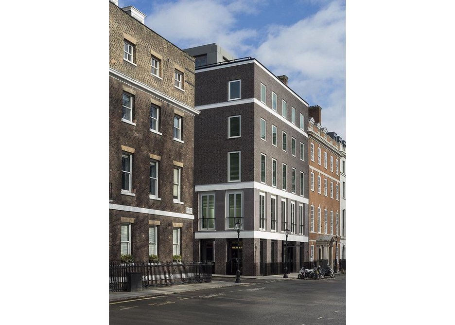 Chatham House to the left, the Lutyens' designed number 7 to the right