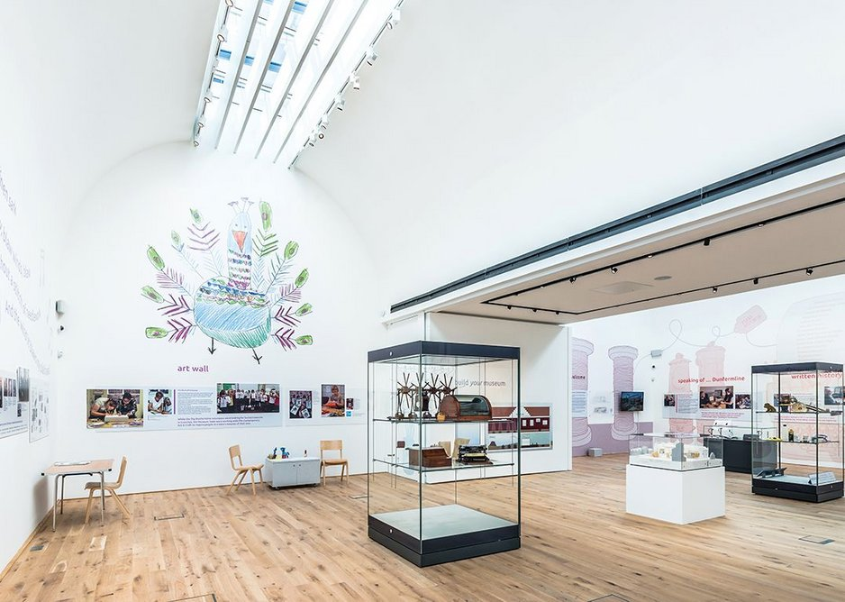 Barrel vaults create volumetric interest and skylights flood the gallery with even, natural light.