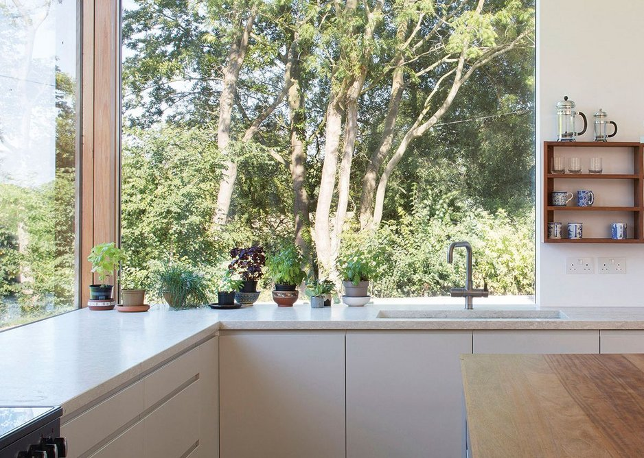 The recurring motif of corner post with windows either side, here in the kitchen.