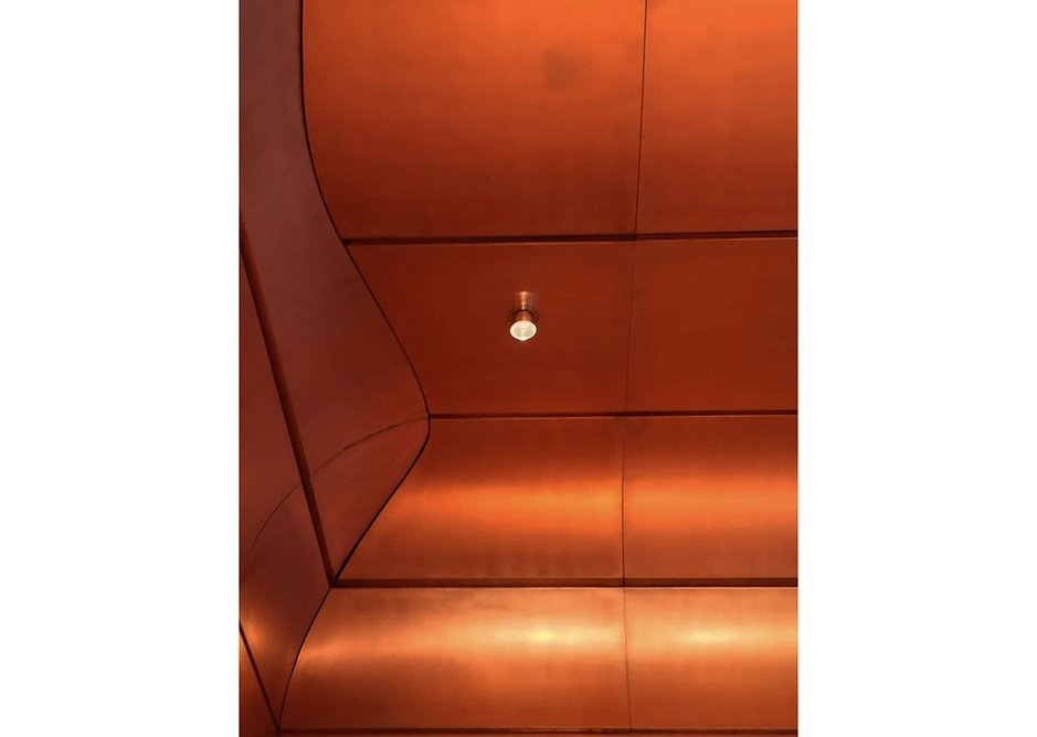 Light fixtures accord with the copper theme.