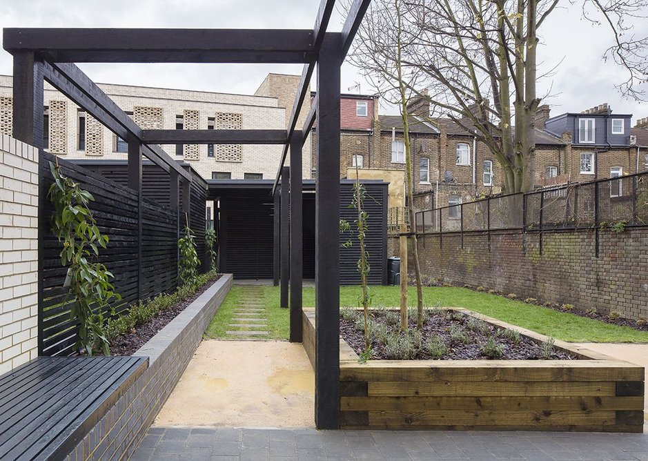 Private courtyard garden: The super shed or garden room at the end of the segmented, landscaped space.