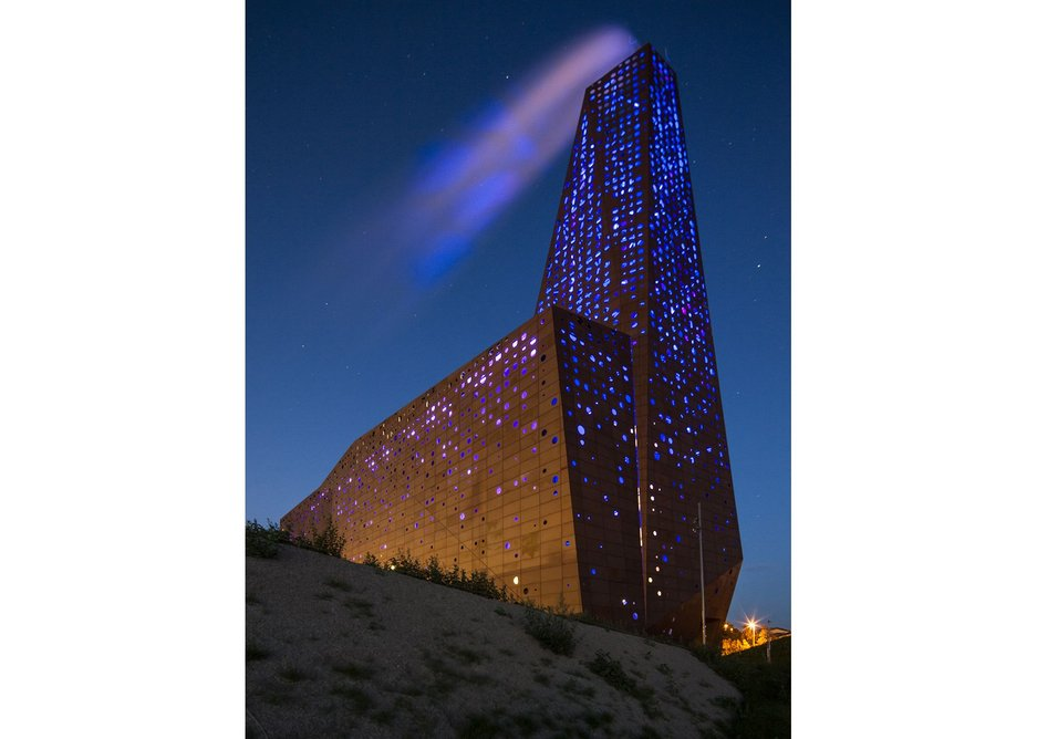 Lights glow through the perforations to create a dramatic effect at night.