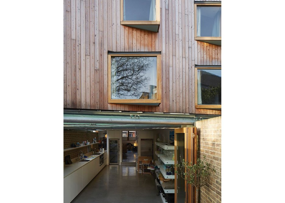 As on the front, the kitchen has layers of openness with a canopy and folding doors for different conditions.