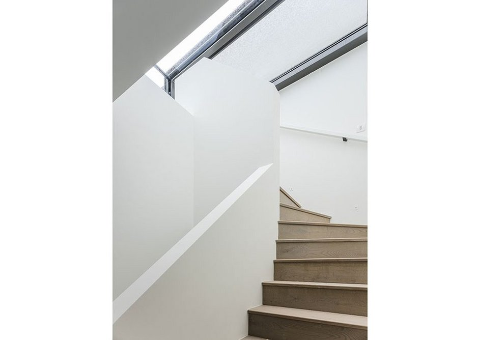 Duplexes and houses have stairs rising to sliding glass roofs opening onto roof terraces.