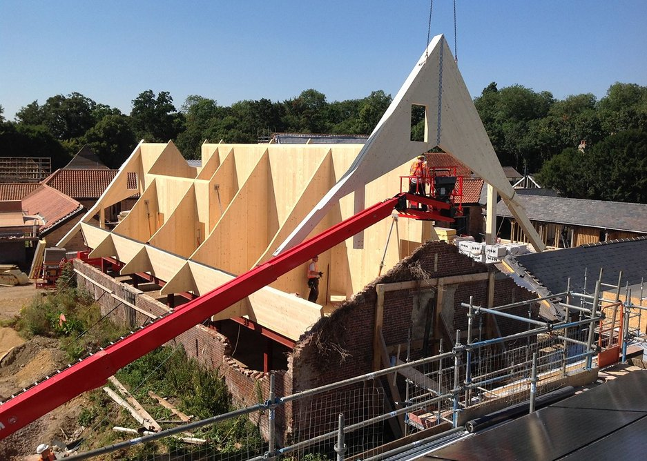 CLT being installed into one of the barns at Anstey Hall.