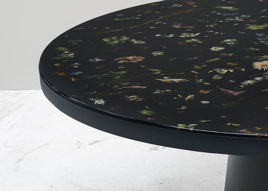 Flora, a table incorporated real flowers in resin designed by Marcin Rusak.
