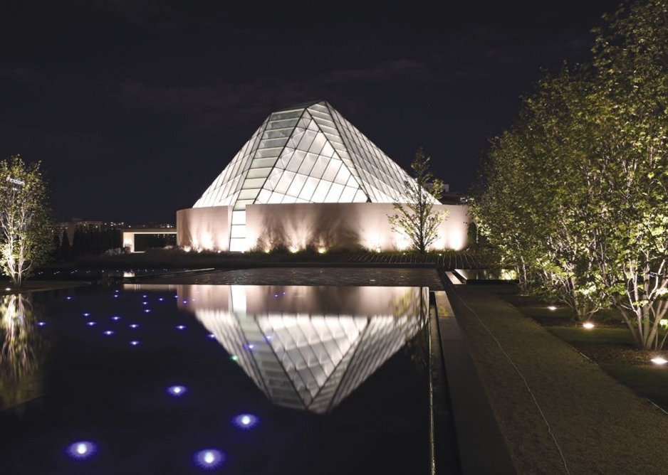 The spirit of Wright: double-skin glass roof of Correa's Ismaili Centre prayer hall, aligned with Mecca, acts as a glowing beacon for the complex.