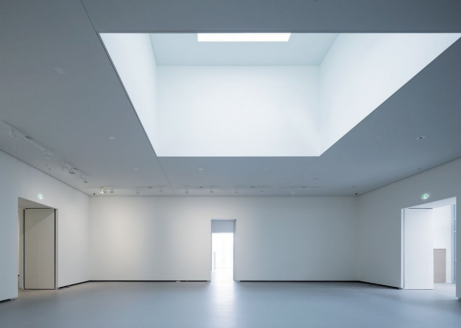 Unlike Bilbao, the original gallery spaces bear no relationship to the skin that covers them.