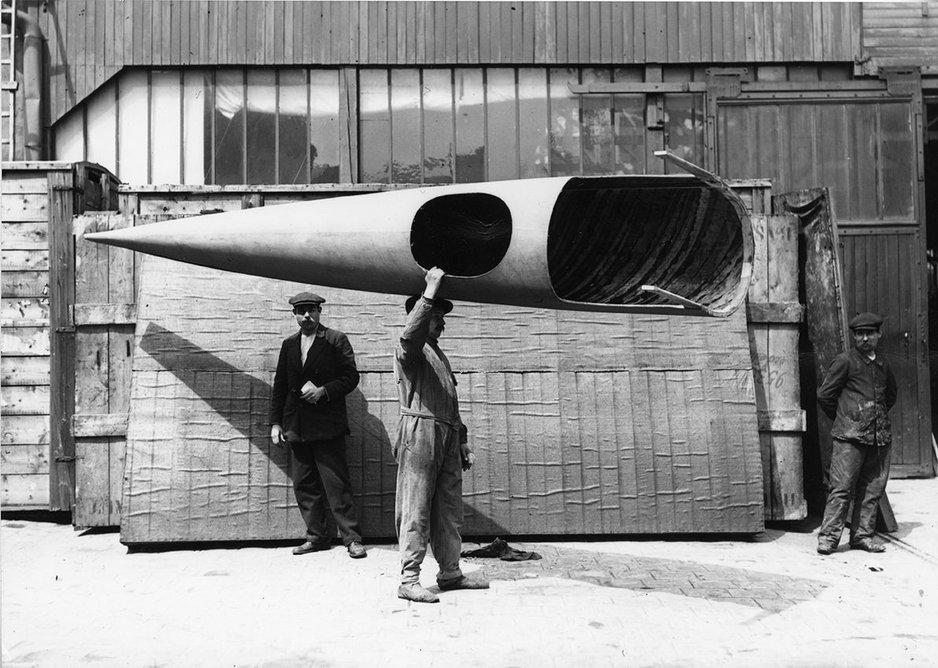 Workman carrying a complete Deperdussin monocoque fuselage, Deperdussin factory, Paris, about 1912.
