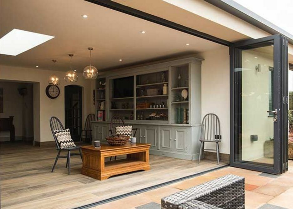 Kitchen dining in Norfolk: The fixed lantern rooflight implies a division between the dining and kitchen areas.