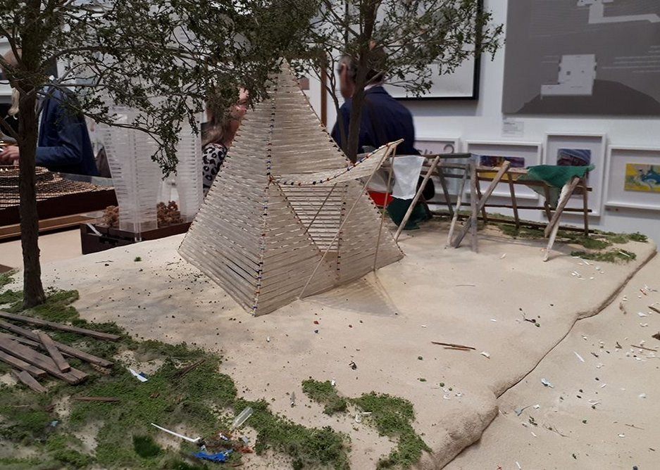 Shelter made from waste plastic bottles by small.