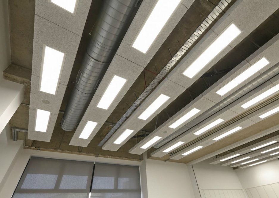 Heradesign ceiling rafts shown with exposed services and lighting.