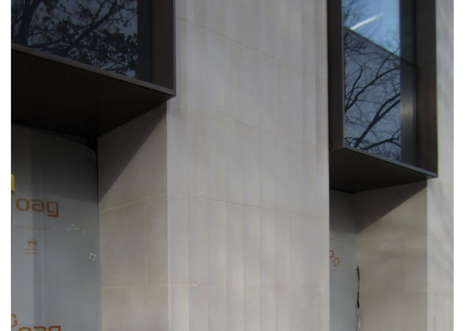 Panels junction with bronze painted aluminium cladding.