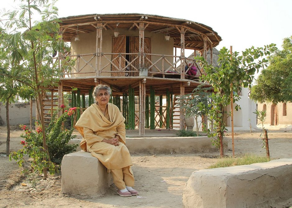 Yasmeen Lari outside a women's centre, built on stilts to survive floods in Sindh.
