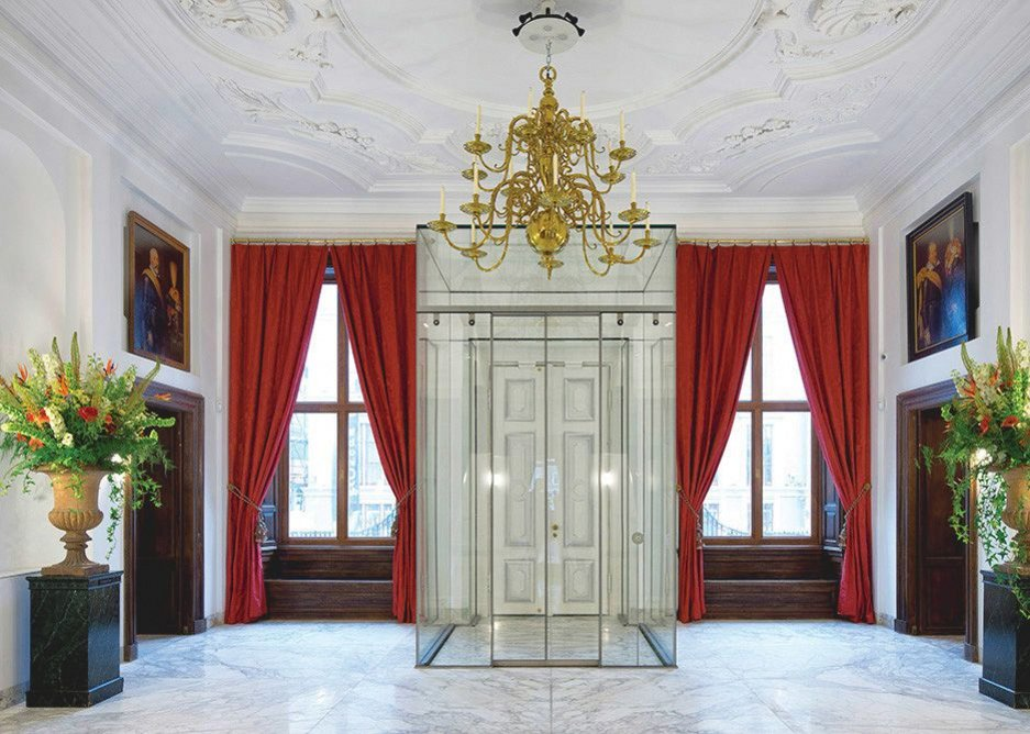 The Mauritshuis vestibule, where a hydraulic lift, encased by glass, accesses the museum directly from the basement lobby.