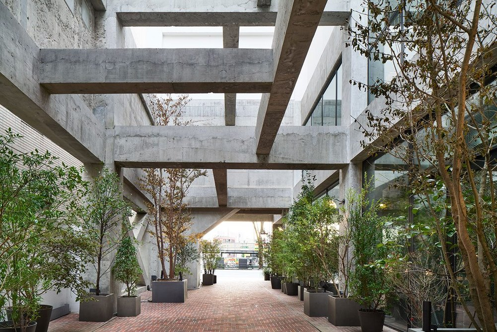 Locals and guests alike can walk along an art-lined public walkway that cuts between the hotel's Heritage Tower and the new Green Tower, linking the main street to a network of back streets.