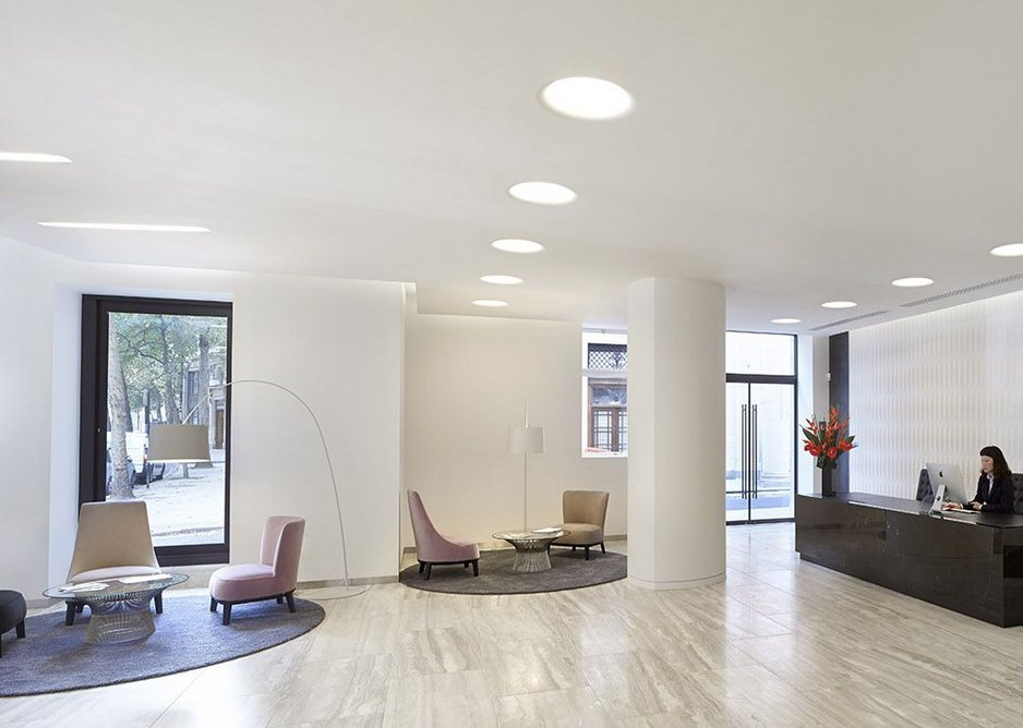 South east wing reception with curved plaster wall.