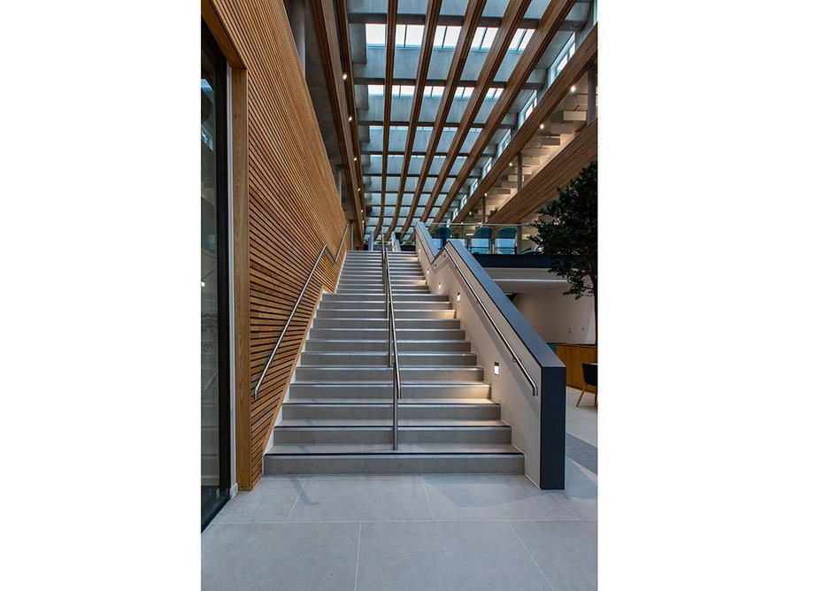 UKHO is a 11,000 square foot office space incorporating a central atrium where employees can communicate, collaborate and relax.