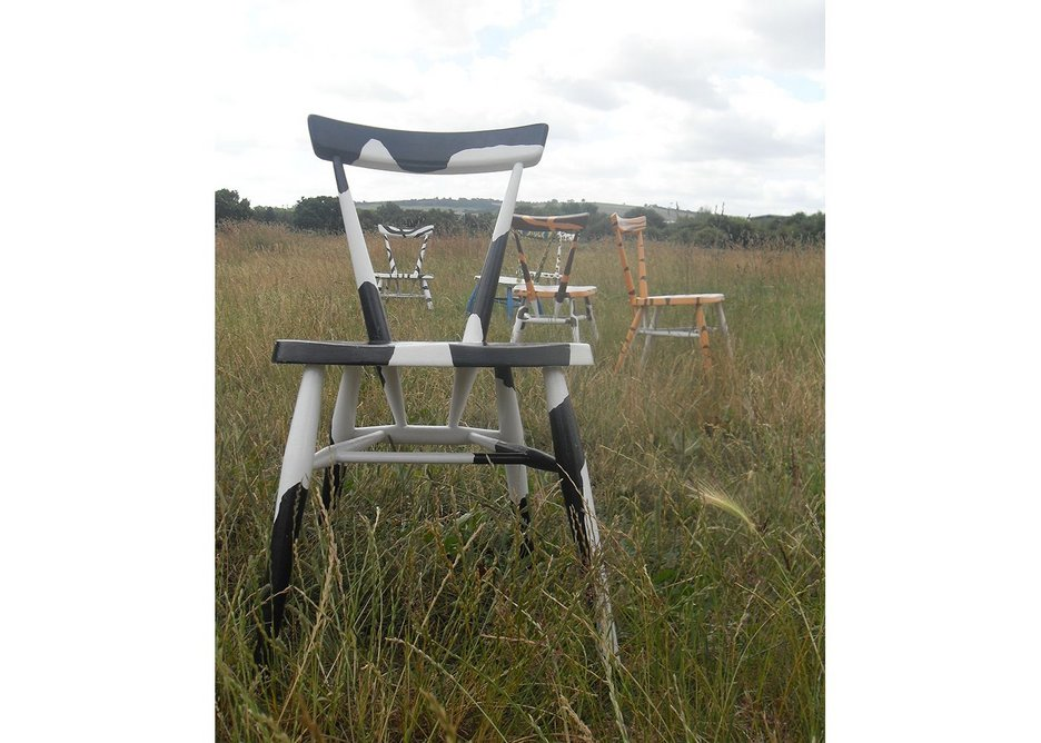 Reworked chairs, in a field.