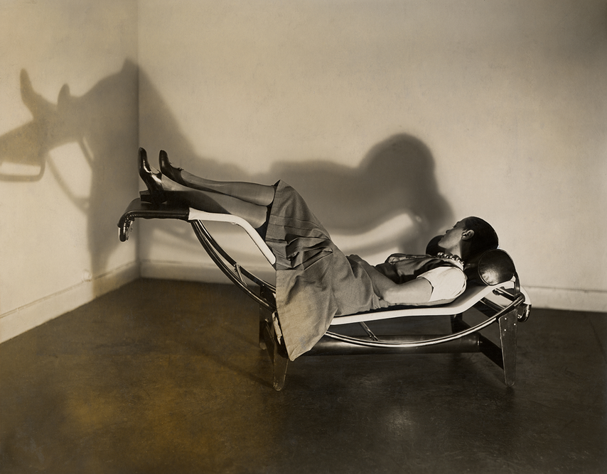 Charlotte Perriand on the chaise longue basculante B306, 1929. © AChP/ © ADAGP, Paris and DACS, London 2021. From Charlotte Perriand: The Modern Life at the Design Museum