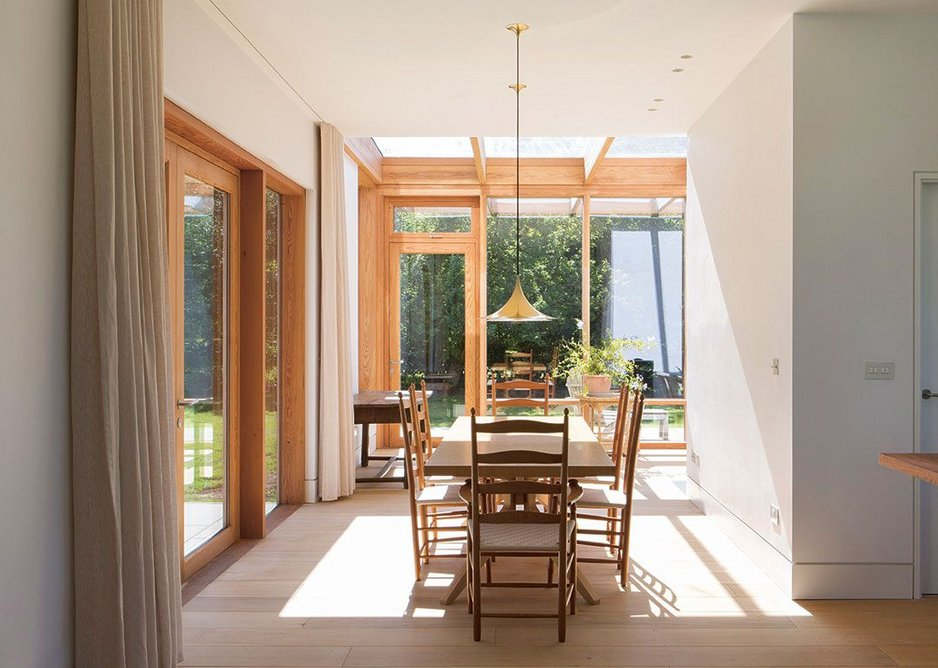 Looking the other way from the kitchen to the dining area and conservatory beyond.