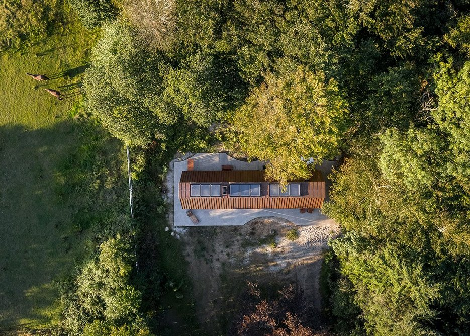 Aerial view of The Author's House in its tranquil landscape.