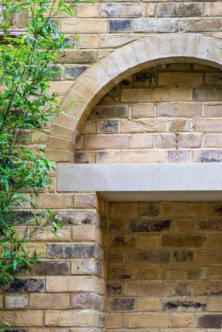 Detail of fountain lintel in garden.