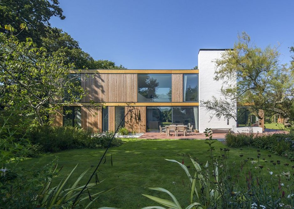Private category – Woodpeckers house by Strom Architects, New Forest, Hampshire. Timber-framed replacement for a 1930s bungalow. on wooded site.