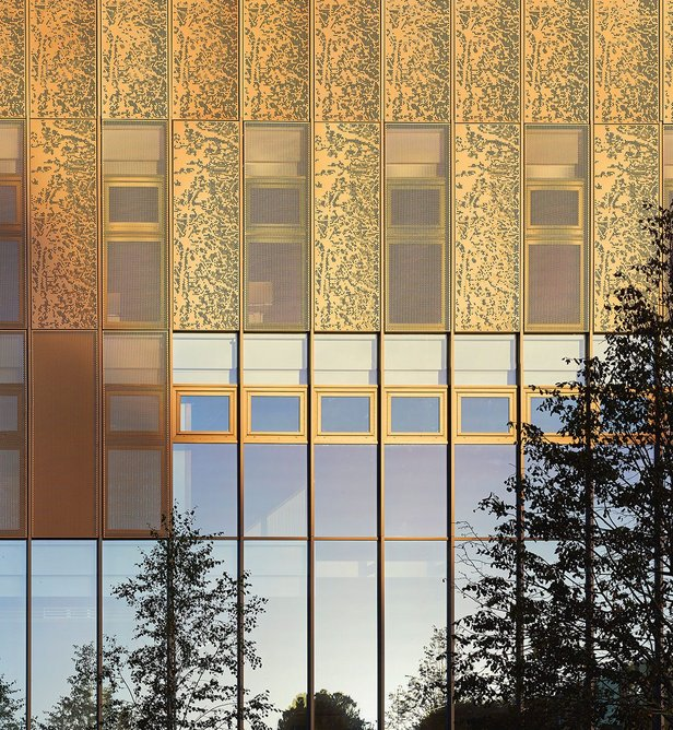 Facades are composed of concrete panels interspersed with perforated anodised aluminium ventilation panels. 'The warm hues and natural tones of the materials play well with the changing quality of light throughout the day and the seasons, discretely animating the facades', suggests the architect.