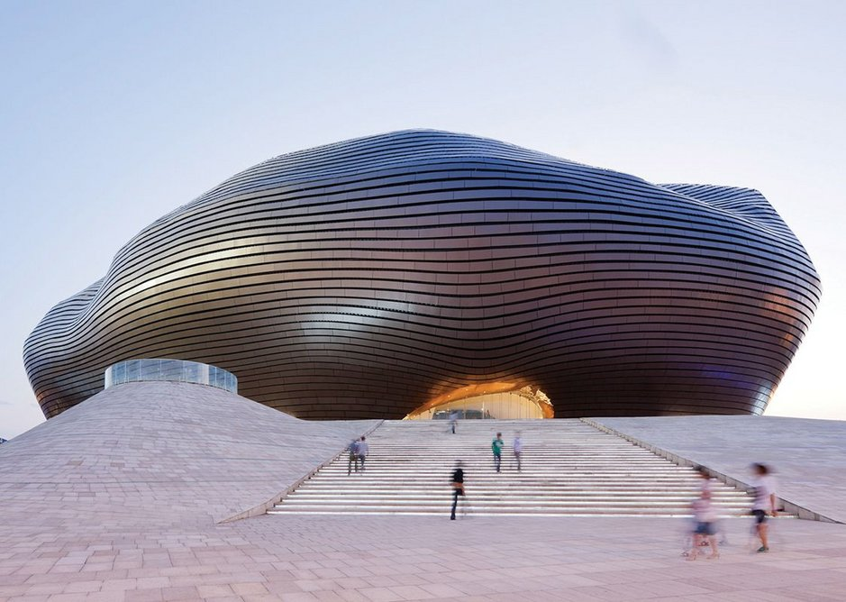 Ordos Museum, completed in 2011, is 'a giant UFO in the Gobi desert'. The city is mired in controversy: the conflict between long standing traditions and dreams for the future.